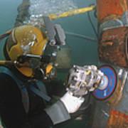 U.s. Navy Diver Uses A Grinder To File Art Print by Stocktrek Images