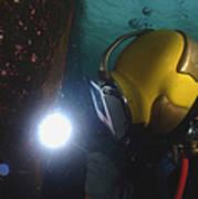U.s. Navy Diver Welds A Repair Patch Art Print