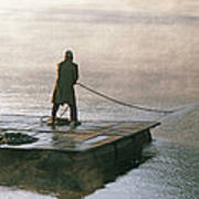 Villager On Raft Crosses Lake Phewa Tal Art Print by Gordon Wiltsie