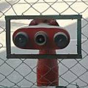 Water Hydrants Built Into A Wire Mesh Fence Art Print