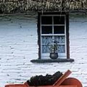 Wheelbarrow In Front Of A Window Of A Art Print