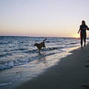 Woman And Dog Running On Beach, Nags Art Print