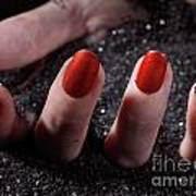 Woman Hand With Red Nail Polish Buried In Black Sand Art Print