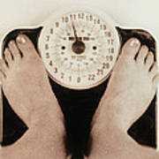 Woman's Feet On A Set Of Weighing Scales Art Print