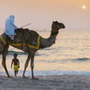 Little Boy Stares In Amazement At A Camel Riding On Marina Beach In Dubai, United Arab Emirates -  Art Print