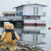 Cheerful Teddy Bear In Knitted Scarf Stand By The Riverside Beside The Port Art Print