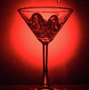 Cocktail Glass With Splashes On Red Background Art Print