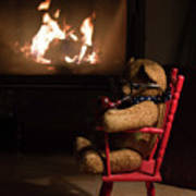 Old Teddy Bear Sitting Front Of The Fireplace In A Cold Night Art Print