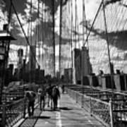 people walking over the brooklyn bridge between cables towards lower manhattan New York City USA Art Print
