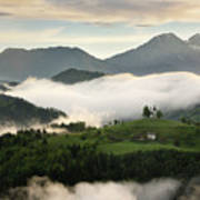 Rolling Fog At Sunrise In The Skofjelosko Hills With St Thomas C Art Print