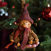 Silly Old Monkey Toy In A Child Hands Under The Christmas Tree Art Print