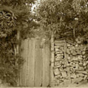 Wood Gate In A Wall Of Stones Art Print