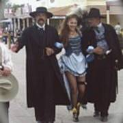 Wyatt Earp  Doc Holiday Escort  Woman  With O.k. Corral In  Background 2004 Art Print