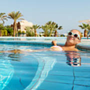 Young Woman Enjoying Warm Water In Pool Art Print