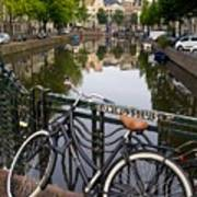 Bicycle Parked At The Bridge In Amsterdam. Netherlands. Europe Art Print