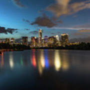 Clouds Roll Over The Austin Skyline As The Neon Reflects In The Glass-like Waters Of Lady Bird Lake Art Print