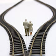 Figurines Between Two Tracks Leading Into Different Directions Symbolic Image For Making Decisions. Art Print