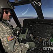 Pilot Operating The Cockpit Of A Uh-60 Art Print