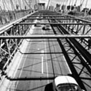 traffic vehicles driving over the worn tarmac on brooklyn bridge New York City USA Art Print