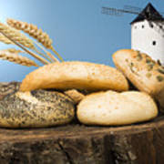 Different Breads And Windmill In The Background Art Print by Deyan Georgiev