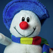 A Cute Little Soft Snowman With A Blue Hat And A Colorful Scarf Art Print