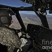 Pilot Operating The Cockpit Of A Uh-60 Art Print