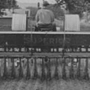 A Farmer Driving A Tractor Art Print