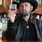 A Bearded Cowboy In Black Contemplates His Whiskey In A Saloon Art Print