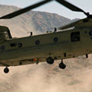 A Ch-47 Chinook Helicopter Kicks Art Print