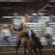 A Cowboy Rides A Bucking Bronco Art Print