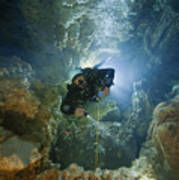 A Diver Ascends A Deep Shaft In Dans Art Print by Wes C. Skiles