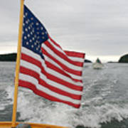 A Flag Waves On The Stern Of A Maine Art Print