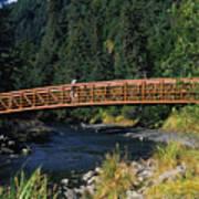 A Hiker Crosses A Bridge Art Print