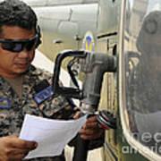 A Honduran Crew Chief Consults Art Print