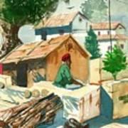 A Man Sitting Near A Tropical Village House Art Print