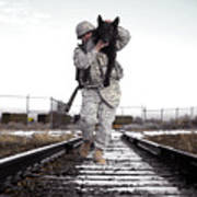 A Military Dog Handler Uses An Art Print by Stocktrek Images