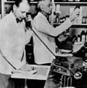 A Pharmacist Demonstrates The Use Of An Art Print