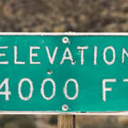 A Weathered Elevation Sign On Highway Art Print