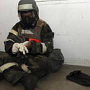 Airman Dons His Chemical Warfare Art Print by Stocktrek Images