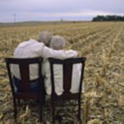 An Elderly Couple Embrace Art Print