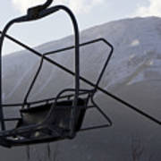 An Empty Chair Lift At A Ski Resort Print by Tim Laman