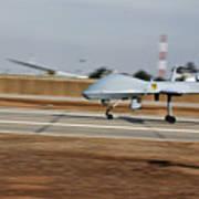 An Mq-1c Sky Warrior Uav Lands At Camp Art Print by Stocktrek Images