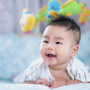 Asian Newborn Baby Smile In A Bed With Fish And Animal Mobile Art Print