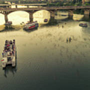 Bat Watchers Stand In Tour Boats As The Bats Take Flight During Sunset On The Congress Avenue Bridge Art Print