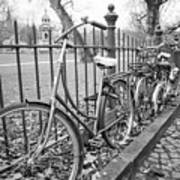 Bicycles Parked At Fence On Street, Netherlands Art Print