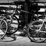 Black And White Leaning Bikes Art Print
