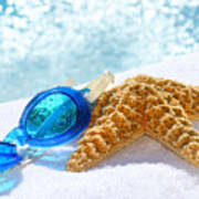 Blue Goggles On A White Towel  Art Print by Sandra Cunningham