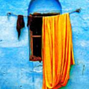 Blue Wall With Orange Sari Art Print