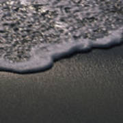 Blurred Motion Of A Wave On The Shore Art Print