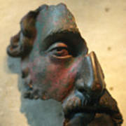 Bronze Fragment Of A Human Face Art Print